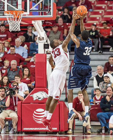 Arkansas Razorbacks forward Moses Kingsley (33) with a block during a basketball game between Arkansas and North Florida on December 22, 2015.    (Alan Jamison, Nate Allen Sports Service)