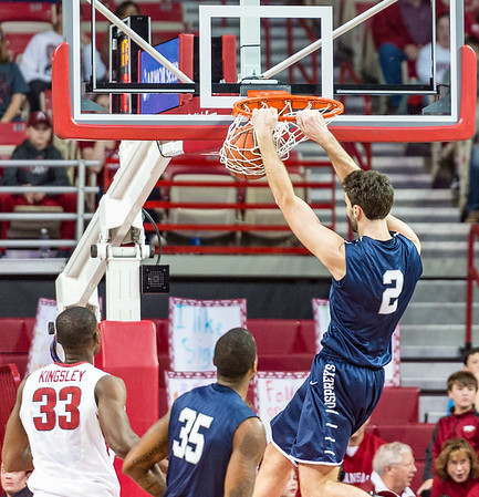 North Florida Ospreys guard Beau Beech (2) with a dunk during a basketball game between Arkansas and North Florida on December 22, 2015.    (Alan Jamison, Nate Allen Sports Service)