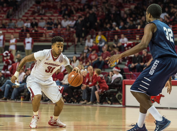 Arkansas Razorbacks guard Anton Beard (31) dribbles the ball during a basketball game between Arkansas and North Florida on December 22, 2015.    (Alan Jamison, Nate Allen Sports Service)