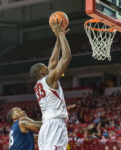 Arkansas Razorbacks forward Moses Kingsley (33) goes up for a shot during a basketball game between Arkansas and North Florida on December 22, 2015.    (Alan Jamison, Nate Allen Sports Service)