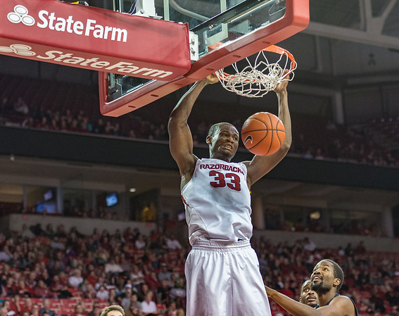 Arkansas Razorbacks forward Moses Kingsley (33) with a dunk during a basketball game between Arkansas and North Florida on December 22, 2015.    (Alan Jamison, Nate Allen Sports Service)