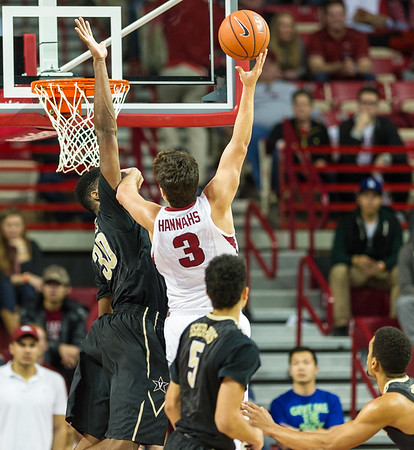 Arkansas Razorbacks guard Dusty Hannahs (3) shoots over Vanderbilt Commodores center Damian Jones (30) during a basketball game between Arkansas and Vanderbilt on January 5, 2016.    (Alan Jamison, Nate Allen Sports Service)