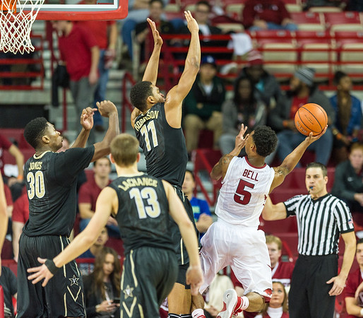 Arkansas Razorbacks guard Anthlon Bell (5) with a shot against Vanderbilt Commodores forward Jeff Roberson (11) during a basketball game between Arkansas and Vanderbilt on January 5, 2016.    (Alan Jamison, Nate Allen Sports Service)