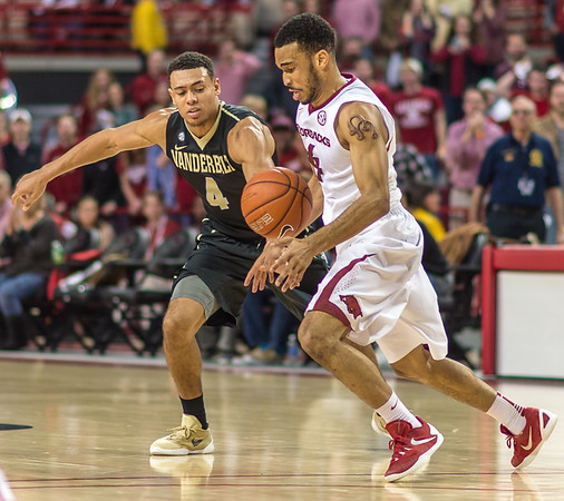 Arkansas Razorbacks guard Jabril Durham (4) with a key steal against Vanderbilt Commodores guard Wade Baldwin IV (4) in overtime during a basketball game between Arkansas and Vanderbilt on January 5, 2016.    (Alan Jamison, Nate Allen Sports Service)