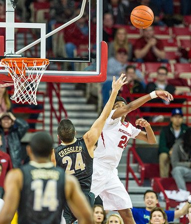 Arkansas Razorbacks guard Jimmy Whitt (24) gets a block during a basketball game between Arkansas and Vanderbilt on January 5, 2016.    (Alan Jamison, Nate Allen Sports Service)