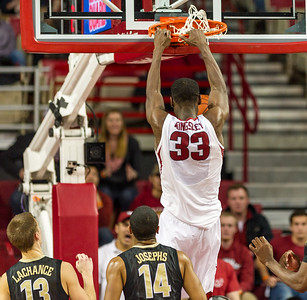 Arkansas Razorbacks forward Moses Kingsley (33) with a slam dunk during a basketball game between Arkansas and Vanderbilt on January 5, 2016.    (Alan Jamison, Nate Allen Sports Service)