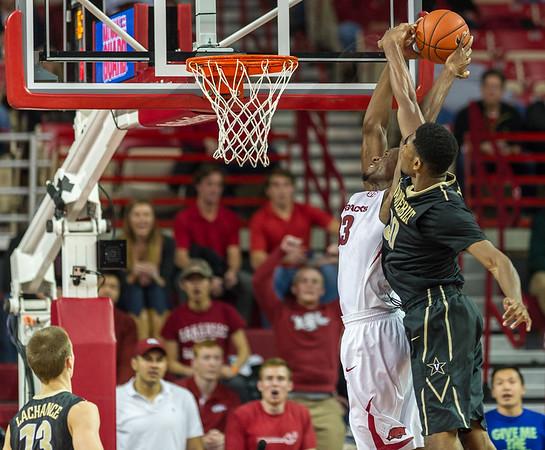 Arkansas Razorbacks forward Moses Kingsley (33) drives past Vanderbilt Commodores center Damian Jones (30) for a basket during a basketball game between Arkansas and Vanderbilt on January 5, 2016.    (Alan Jamison, Nate Allen Sports Service)