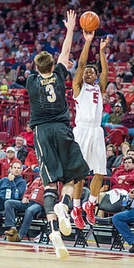 Arkansas Razorbacks guard Anthlon Bell (5) shoots a three pointer during a basketball game between Arkansas and Vanderbilt on January 5, 2016.    (Alan Jamison, Nate Allen Sports Service)