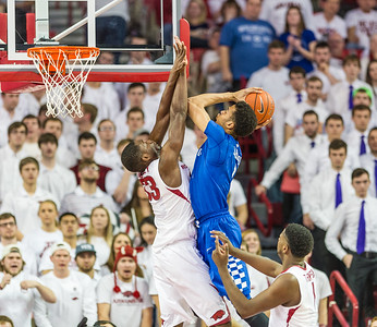 Arkansas Razorbacks forward Moses Kingsley (33) defends a Kentucky shot during a basketball game between Arkansas Razorbacks and Kentucky Wildcats on January 21, 2016.    (Alan Jamison, Nate Allen Sports Service)