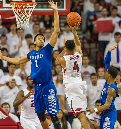 Arkansas Razorbacks guard Jabril Durham (4) shoots while being defended by Kentucky Wildcats forward Skal Labissiere (1) during a basketball game between Arkansas Razorbacks and Kentucky Wildcats on January 21, 2016.    (Alan Jamison, Nate Allen Sports Service)