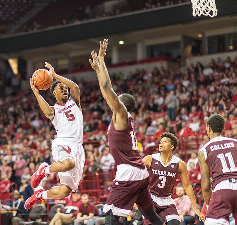 Arkansas Razorbacks guard Anthlon Bell (5) shoots during a basketball game between Arkansas Razorbacks and Texas A&M Aggies  on January 27, 2016.    (Alan Jamison, Nate Allen Sports Service)