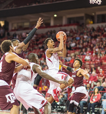 Arkansas Razorbacks guard Anthlon Bell (5) shoots a layup during a basketball game between Arkansas Razorbacks and Texas A&M Aggies  on January 27, 2016.    (Alan Jamison, Nate Allen Sports Service)
