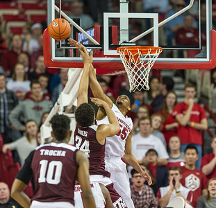 Arkansas Razorbacks forward Keaton Miles (55) blocks a shot by Texas A&M Aggies center Tyler Davis (34) during a basketball game between Arkansas Razorbacks and Texas A&M Aggies  on January 27, 2016.    (Alan Jamison, Nate Allen Sports Service)