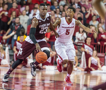 Texas A&M Aggies guard Danuel House (23) drives past Arkansas Razorbacks guard Anthlon Bell (5) during a basketball game between Arkansas Razorbacks and Texas A&M Aggies  on January 27, 2016.    (Alan Jamison, Nate Allen Sports Service)