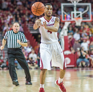 Arkansas Razorbacks guard Jabril Durham (4) passes inside during a basketball game between Arkansas Razorbacks and Texas A&M Aggies  on January 27, 2016.    (Alan Jamison, Nate Allen Sports Service)