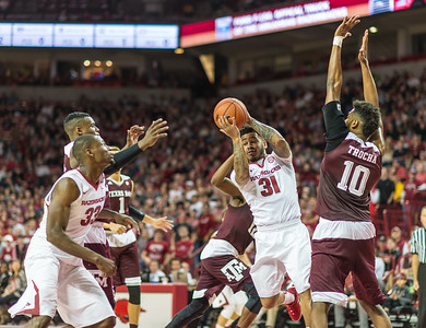 Arkansas Razorbacks guard Anton Beard (31) passes inside to Arkansas Razorbacks forward Moses Kingsley (33) during a basketball game between Arkansas Razorbacks and Texas A&M Aggies  on January 27, 2016.    (Alan Jamison, Nate Allen Sports Service)