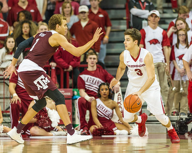 Arkansas Razorbacks guard Dusty Hannahs (3) dribbles during a basketball game between Arkansas Razorbacks and Texas A&M Aggies  on January 27, 2016.    (Alan Jamison, Nate Allen Sports Service)