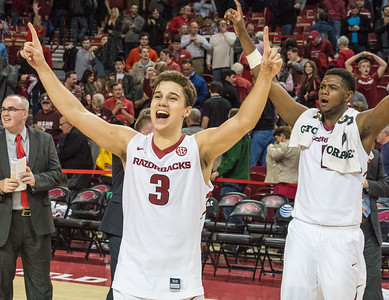 Arkansas Razorbacks guard Dusty Hannahs (3) and Arkansas Razorbacks forward Trey Thompson (1) celebrate after winning a basketball game between Arkansas Razorbacks and Texas A&M Aggies  on January 27, 2016.    (Alan Jamison, Nate Allen Sports Service)