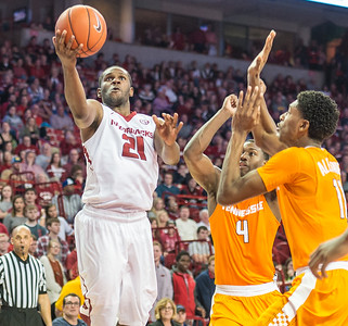 Arkansas Razorbacks guard Manuale Watkins (21) drives to the basket during a basketball game between Arkansas Razorbacks and Tennessee Volunteers  on February 6, 2016.    (Alan Jamison, Nate Allen Sports Service)