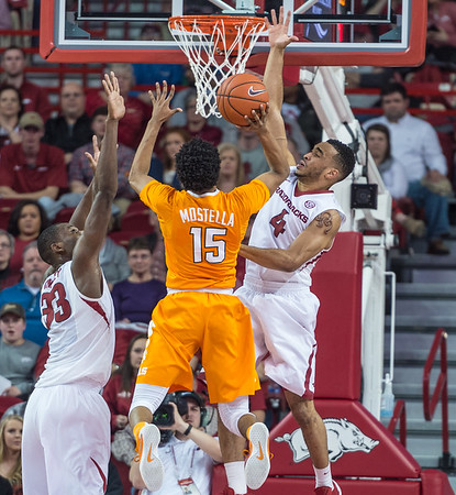 Arkansas Razorbacks guard Jabril Durham (4) defends a shot by Tennessee Volunteers guard Detrick Mostella (15) during a basketball game between Arkansas Razorbacks and Tennessee Volunteers  on February 6, 2016.    (Alan Jamison, Nate Allen Sports Service)