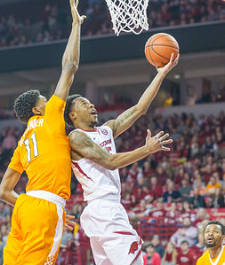 Arkansas Razorbacks guard Anthlon Bell (5) with a reverse layup during a basketball game between Arkansas Razorbacks and Tennessee Volunteers  on February 6, 2016.    (Alan Jamison, Nate Allen Sports Service)