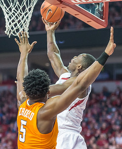 Arkansas Razorbacks forward Moses Kingsley (33) with a reverse layup during a basketball game between Arkansas Razorbacks and Tennessee Volunteers  on February 6, 2016.    (Alan Jamison, Nate Allen Sports Service)