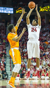 Arkansas Razorbacks guard Jimmy Whitt (24) shoots over Tennessee Volunteers guard Detrick Mostella (15) during a basketball game between Arkansas Razorbacks and Tennessee Volunteers  on February 6, 2016.    (Alan Jamison, Nate Allen Sports Service)