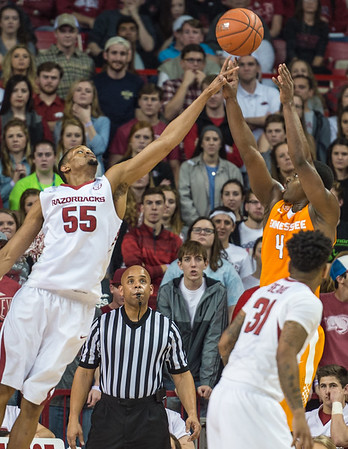 Arkansas Razorbacks forward Keaton Miles (55) defends a shot by Tennessee Volunteers forward Armani Moore (4) during a basketball game between Arkansas Razorbacks and Tennessee Volunteers  on February 6, 2016.    (Alan Jamison, Nate Allen Sports Service)
