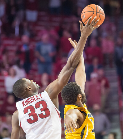 Arkansas Razorbacks forward Moses Kingsley (33) controls the opening tip during a basketball game between Arkansas and Missouri on 2-20-16.   (Alan Jamison, Nate Allen Sports Service)