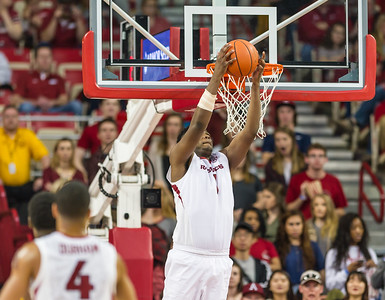 Arkansas Razorbacks forward Trey Thompson (1) with a backwards dunk during a basketball game between Arkansas and Missouri on 2-20-16.   (Alan Jamison, Nate Allen Sports Service)