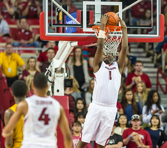Arkansas Razorbacks forward Trey Thompson (1) with a backwards stuff during a basketball game between Arkansas and Missouri on 2-20-16.   (Alan Jamison, Nate Allen Sports Service)