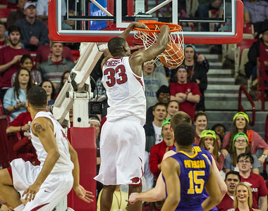 Arkansas Razorbacks forward Moses Kingsley (33) dunks the ball during a basketball game between Arkansas and LSU on 2-23-16.   (Alan Jamison, Nate Allen Sports Service)