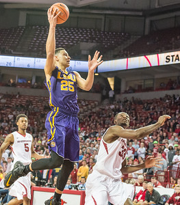 LSU Tigers forward Ben Simmons (25) shoots over Arkansas Razorbacks forward Moses Kingsley (33) during a basketball game between Arkansas and LSU on 2-23-16.   (Alan Jamison, Nate Allen Sports Service)