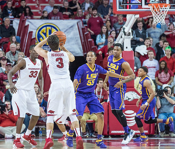 Arkansas Razorbacks guard Dusty Hannahs (3) shoots a three point basket during a basketball game between Arkansas and LSU on 2-23-16.   (Alan Jamison, Nate Allen Sports Service)