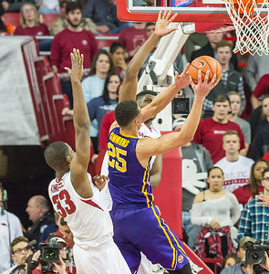Arkansas Razorbacks forward Trey Thompson (1) defends a shot by LSU Tigers forward Ben Simmons (25) during a basketball game between Arkansas and LSU on 2-23-16.   (Alan Jamison, Nate Allen Sports Service)