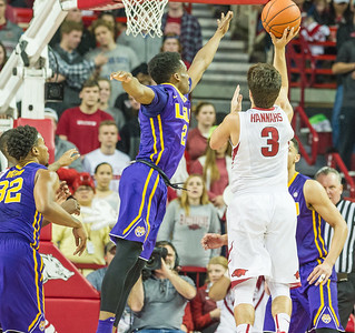 Arkansas Razorbacks guard Dusty Hannahs (3) shoots a floater during a basketball game between Arkansas and LSU on 2-23-16.   (Alan Jamison, Nate Allen Sports Service)