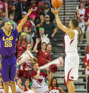Arkansas Razorbacks guard Jabril Durham (4) shoots a jump shoot while being defended by LSU Tigers guard Tim Quarterman (55) during a basketball game between Arkansas and LSU on 2-23-16.   (Alan Jamison, Nate Allen Sports Service)