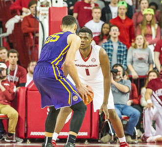 Arkansas Razorbacks forward Trey Thompson (1) guards LSU Tigers forward Ben Simmons (25) during a basketball game between Arkansas and LSU on 2-23-16.   (Alan Jamison, Nate Allen Sports Service)