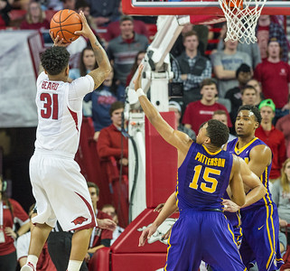 Arkansas Razorbacks guard Anton Beard (31) shoots a jump shot during a basketball game between Arkansas and LSU on 2-23-16.   (Alan Jamison, Nate Allen Sports Service)