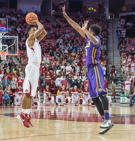 Arkansas Razorbacks guard Anthlon Bell (5) shoots a three point basket during a basketball game between Arkansas and LSU on 2-23-16.   (Alan Jamison, Nate Allen Sports Service)