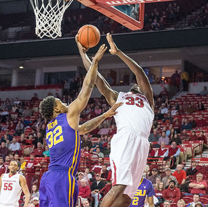 Arkansas Razorbacks forward Moses Kingsley (33) goes up for two over LSU Tigers forward Craig Victor II (32) during a basketball game between Arkansas and LSU on 2-23-16.   (Alan Jamison, Nate Allen Sports Service)
