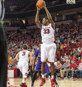 Arkansas Razorbacks forward Moses Kingsley (33) gets a rebound during a basketball game between Arkansas and LSU on 2-23-16.   (Alan Jamison, Nate Allen Sports Service)