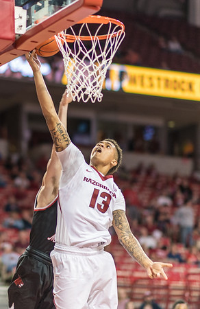 Arkansas Razorbacks forward Dustin Thomas (13) lays up during a basketball game between Arkansas and Central Missouri on Friday, October 28, 2016.  (Alan Jamison, Nate Allen Sports Service)
