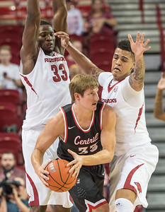 Arkansas Razorbacks forward Dustin Thomas (13) and Moses Kingsley (33) trap Central Missouri forward Kyle Wolf (33) during a basketball game between Arkansas and Central Missouri on Friday, October 28, 2016.  (Alan Jamison, Nate Allen Sports Service)