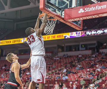Arkansas Razorbacks forward Moses Kingsley (33) dunks during a basketball game between Arkansas and Central Missouri on Friday, October 28, 2016.  (Alan Jamison, Nate Allen Sports Service)