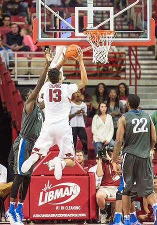 Arkansas Razorbacks forward Dustin Thomas (13) shoots during a basketball game between Arkansas and Fort Wayne on Friday, November 11, 2016.  (Alan Jamison, Nate Allen Sports Service)