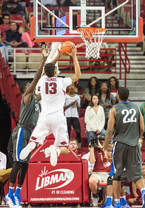 Arkansas Razorbacks forward Dustin Thomas (13) shoots during a basketball game between Arkansas and Fort Wayne on Friday, November 11, 2016.  (Alan Jamison, Nate Allen Sports Service)