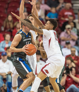 Arkansas Razorbacks forward Dustin Thomas (13) and Dusty Hannahs (3) trap Fort Wayne guard John Konchar (55) during a basketball game between Arkansas and Fort Wayne on Friday, November 11, 2016.  (Alan Jamison, Nate Allen Sports Service)