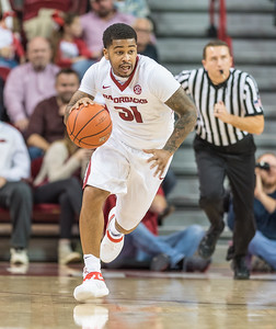 Arkansas Razorbacks guard Anton Beard (31) dribbles during a basketball game between Arkansas and Fort Wayne on Friday, November 11, 2016.  (Alan Jamison, Nate Allen Sports Service)