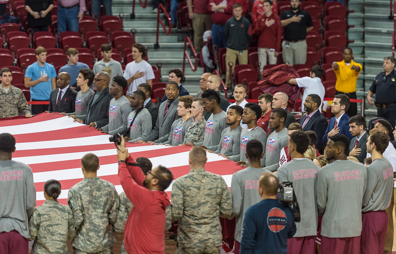 Players hold the flag as the national anthem is performed during a basketball game between Arkansas and Fort Wayne on Friday, November 11, 2016.  (Alan Jamison, Nate Allen Sports Service)